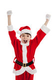 Boy dressed as Santa cheering Stock Image