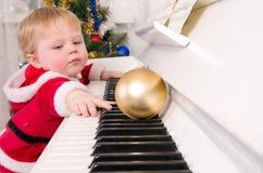 Boy dressed as Santa Claus royalty free stock photos