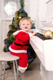 Boy dressed as Santa Claus stock images