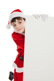 Boy dressed as Santa holding blank sign. Cute 10 year old boy dressed in Santa costume holding blank white sign board isolated on a white background Stock Photography