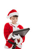 Boy dressed as Santa making a list Stock Images
