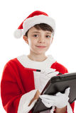 Boy dressed as Santa making a list Stock Photo