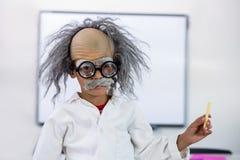 Boy dressed as scientist in classroom. Portrait of boy dressed as scientist in classroom Stock Image