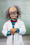 Boy dressed as scientist posing agains board. Portrait of boy dressed as scientist posing agains board in classroom Royalty Free Stock Photography