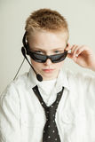 Boy Dressed as Slick Businessman with Head Set Royalty Free Stock Photography
