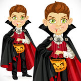 Boy dressed as a vampire with a basket for sweets Royalty Free Stock Photos