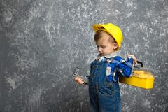 Boy in hard hat with construction line and box of tools royalty free stock photo