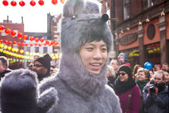 Boy dressed with a furry mouse costume waving his hand Stock Photo