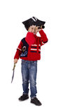 Boy dressed like pirate watching in spyglass Royalty Free Stock Images