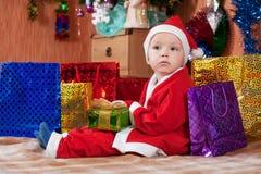Boy dressed like Santa Claus Stock Image