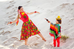 Boy dressed in Mexican costume holding a toy gun Stock Photography