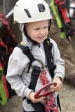 Boy dressed in mountaineering equipment royalty free stock images