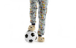 Boy dressed in pyjama and football ball Royalty Free Stock Photo