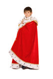 Boy dressed in a robe of King Stock Photo