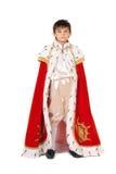 Boy dressed in a robe of King. Little boy dressed in a robe of King royalty free stock photos