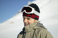Boy dressed in ski clothing. Portrait of a little boy standing on a snowy mountain Stock Photography