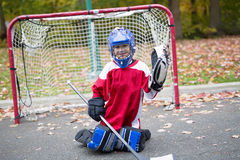 Boy dressed to be the goalie in a street hockey game Royalty Free Stock Images