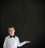 Boy dressed up as businessman holding anything on flat hand Stock Images