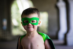 Boy in green mask and cape Stock Images