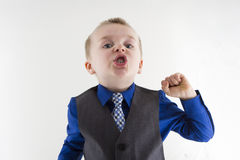 Boy dressed up making faces Royalty Free Stock Photo