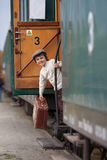Boy, dressed in vintage shirt and hat, with suitcase Royalty Free Stock Image