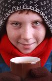 Boy dressed for winter with mug Royalty Free Stock Photos