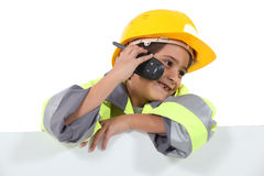 Boy dressed in worker costume Stock Photography