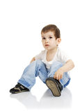 The boy dresses shoes. The little boy without assistance dresses shoes royalty free stock photography