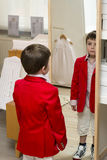 Boy dressing up royalty free stock photography