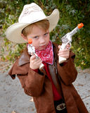Boy Dressing Up As Cowboy. A cute little boy dressed as a cowboy for Halloween royalty free stock images