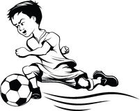 Boy Dribbling a Football Royalty Free Stock Photos