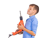 Boy with a drill Royalty Free Stock Images