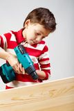 Boy drilling Royalty Free Stock Photography