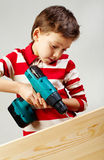 Boy drilling Royalty Free Stock Images