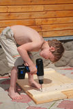 Boy drills an electrodril Stock Photo