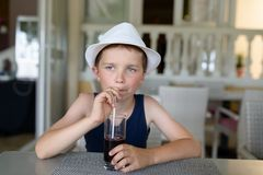 Boy drink fresh cold blackberry juice Stock Image