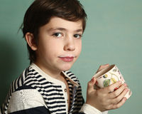 Boy drink milk from floral mug Royalty Free Stock Photo
