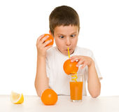 Boy drink orange juice with a straw Stock Images