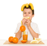 Boy drink orange juice with a straw Stock Image