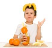 Boy drink orange juice with a straw Stock Photos