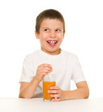 Boy drink orange juice with a straw Royalty Free Stock Images