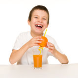 Boy drink orange juice with a straw Royalty Free Stock Image