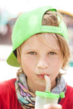 Boy drink in summer day Royalty Free Stock Photo