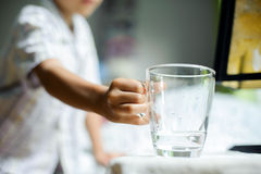 Boy drink water from glass Stock Photos