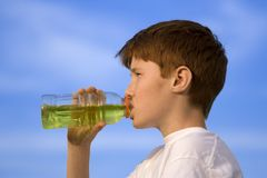 Boy is drinking Royalty Free Stock Image