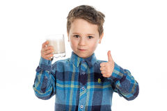 Boy drinking almond milk with thumbs up Royalty Free Stock Image