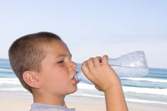 Boy drinking bottled water Stock Photos