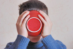 Boy drinking from bowl Stock Photography