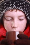 Boy drinking from a brown mug Stock Photo