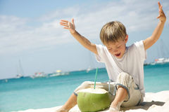 Boy drinking coconut juice on sea background Stock Photo